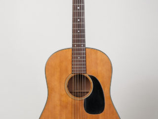 Martin D-12 20 $1445  Converted to Six String